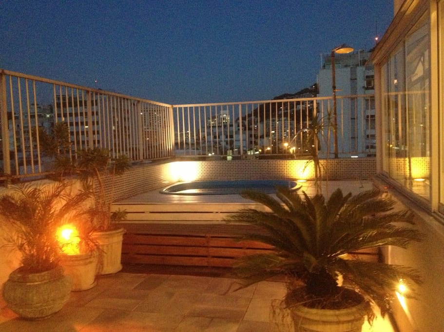 2nd floor outside - terrace at night w/ pool
