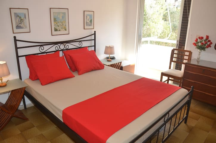 Air-Conditioned main bedroom with comfy double bed and large closet