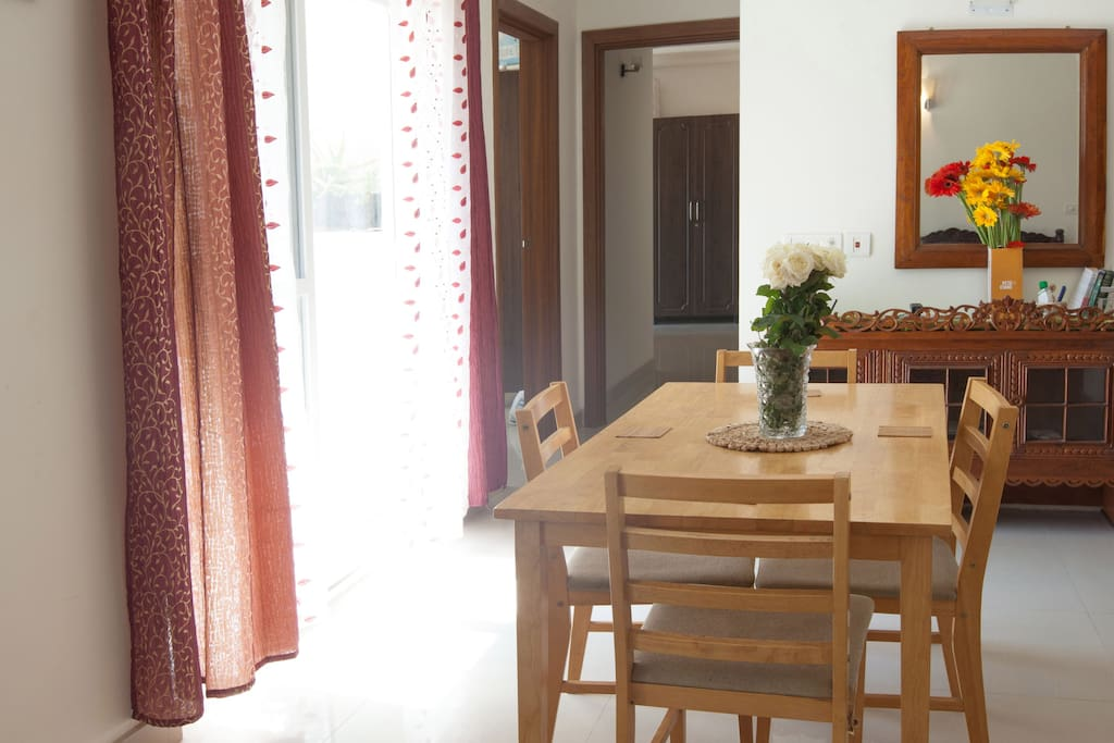 Brightly lit Dining area - with 4 seater dining table, long balcony, adjacent to well equipped open kitchen and a small library