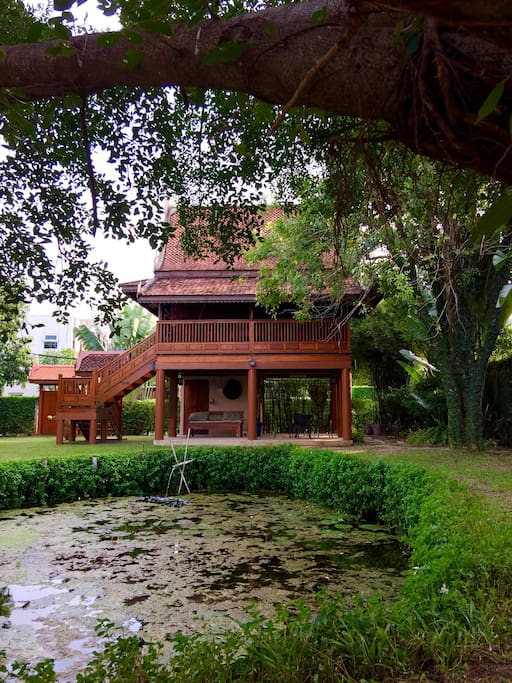 Exterior of the house facing the garden and pond.