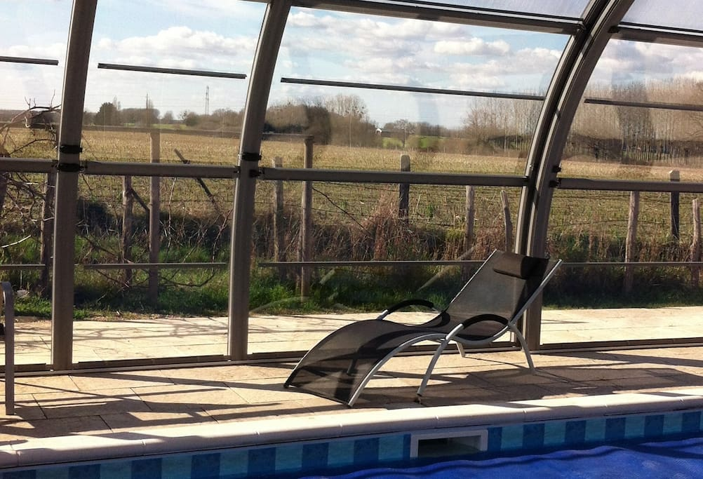 Relax by the 12 metre long swimming pool. The full height cover opens all the way around or can be adjusted to suit the weather.