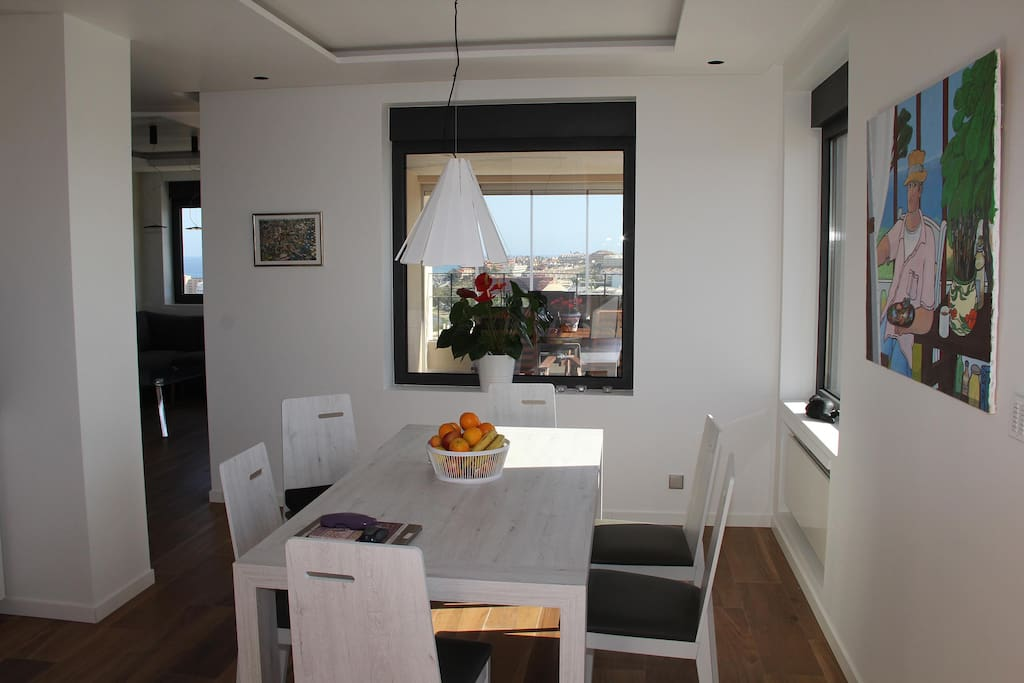 Open plan kitchen with extendable table for up to 12 seats.