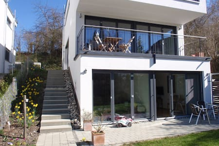 Our holiday flat is on the ground floor of our newly built house. We live in a quiet and exclusive area of Konstanz.   The flat consists of one room, that serves as living- / dining and bedroom. There is a separate kitchen area and a shower room.