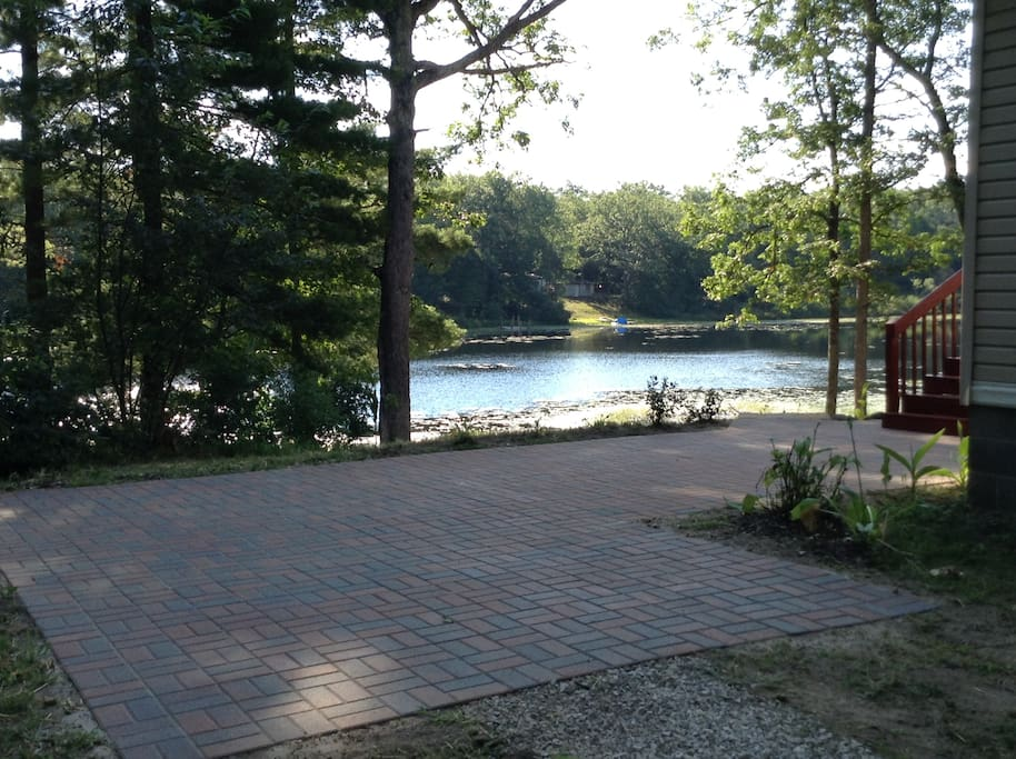 Guests enjoy the serenity of the lake from the patio or main deck.  Ample seating options are available.