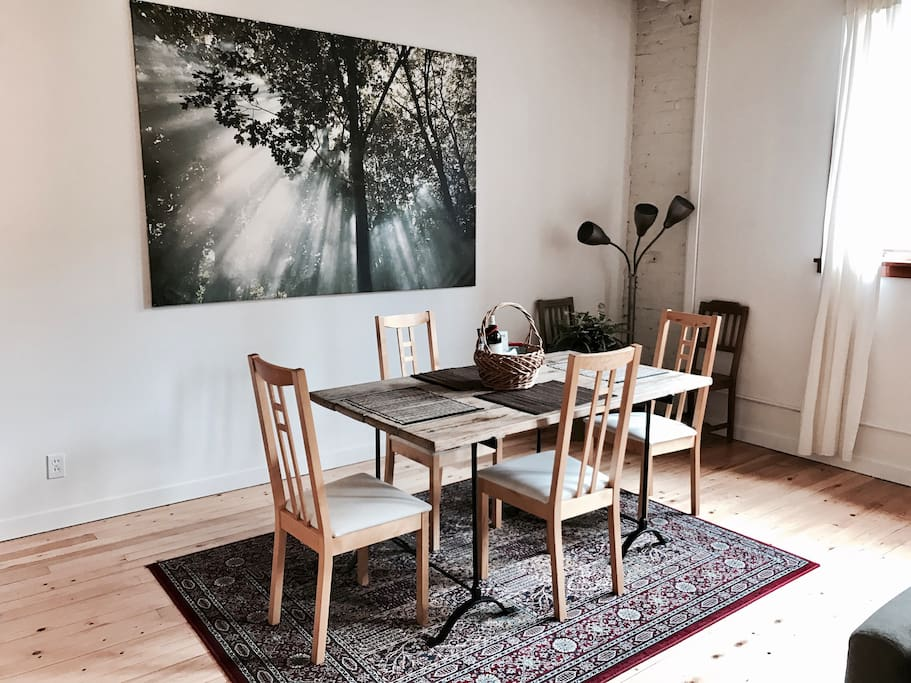 Dining table comfortably accommodates 4-6 guests