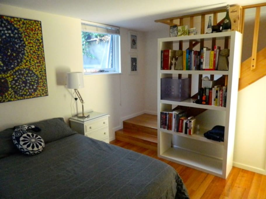 Guest bedroom downstairs with ample storage, hanging space and room to move.