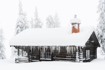 Log cabin by the lake in Lapland
