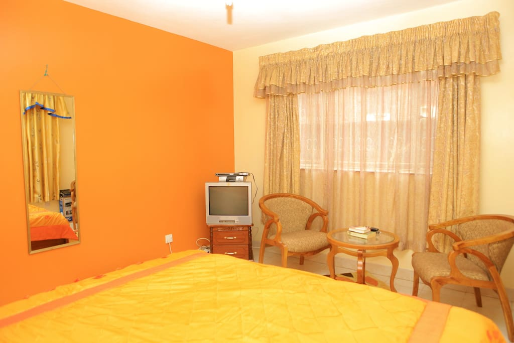 This large master bedroom comes with a larger than King size bed, TV with cable connection and a coffee table and two seats.  Has own bathroom and walk in closets.  Its a home within a home.