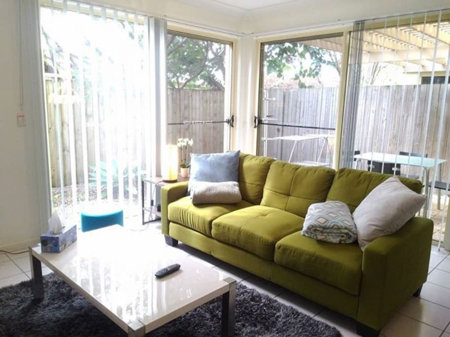Bright living room with comfortable couch