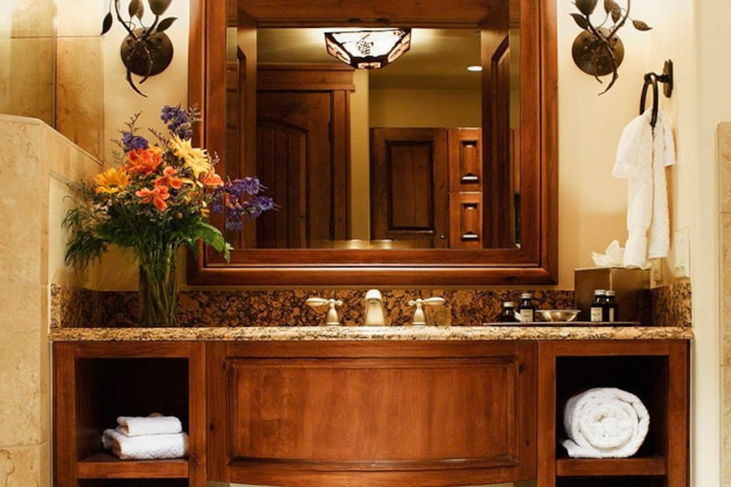 Get ready for your day in the mountains in the pristine bathroom.