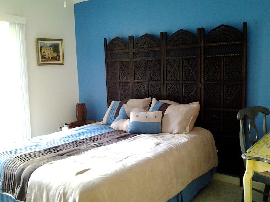 1st floor guest  bedroom with access to the swimming pool