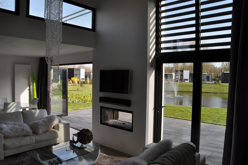 Bifold doors to open livingroom to the garden on the southside. Fireplace with remote control and Sonos Soundsystem.