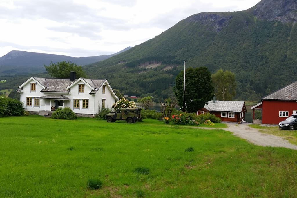Located near old white farmhouse and red barn, 100 meters from the fjord