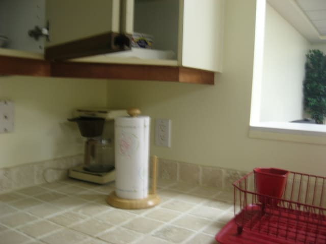 Nice counter tops of tile, double sink with disposal, lazy susan cupboard and dishwasher are all in this corner of the kitchen