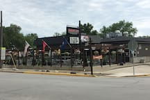 Smokey Jo's Real Pit Barbeque Restaurant.  They have happy hour food and comfort food.  See their website: http://www.smokeyjos.com/