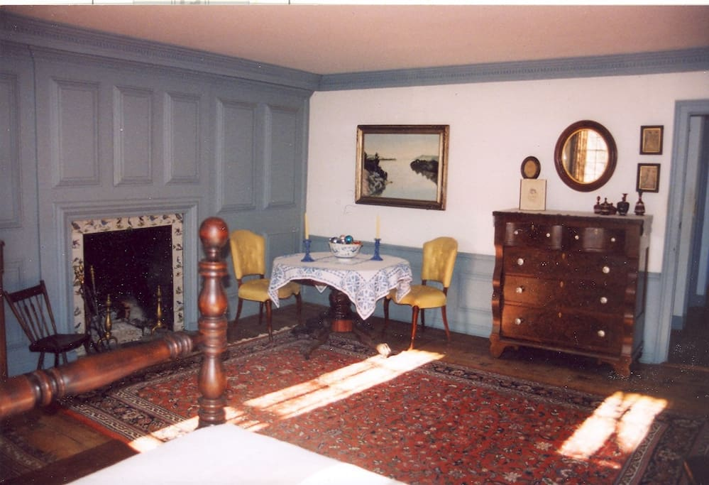Your room has a double bed, original paneling, and lots of space.