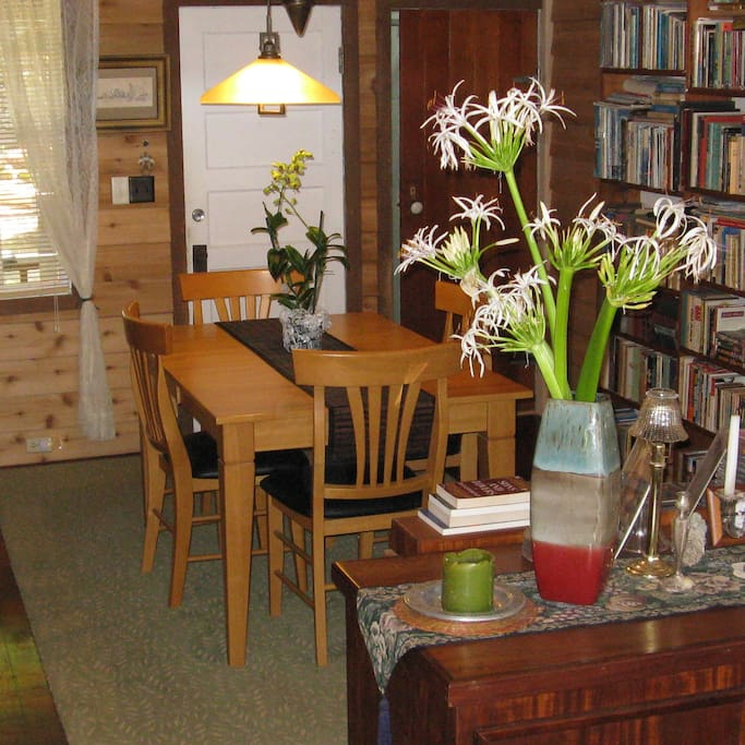 """The vaulted """"foyer"""" is also our Dining Room & Library"""