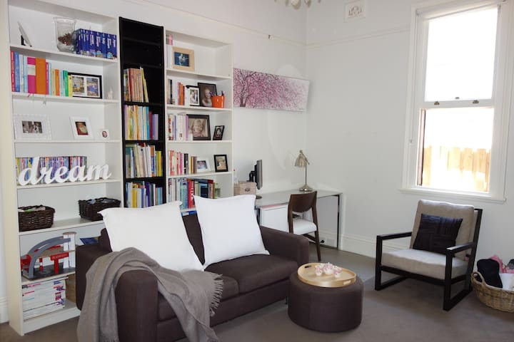Cosy lounge with bookcase library, study area, TV & wireless internet