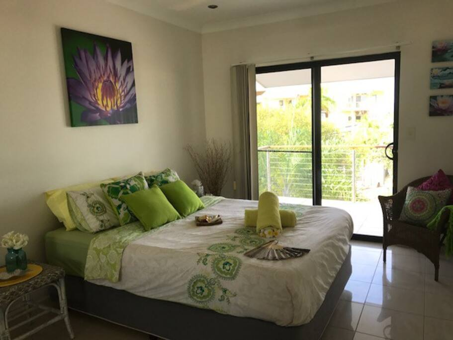Spacious queen bedroom with balcony