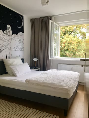 Bedroom with double bed + windows to trees