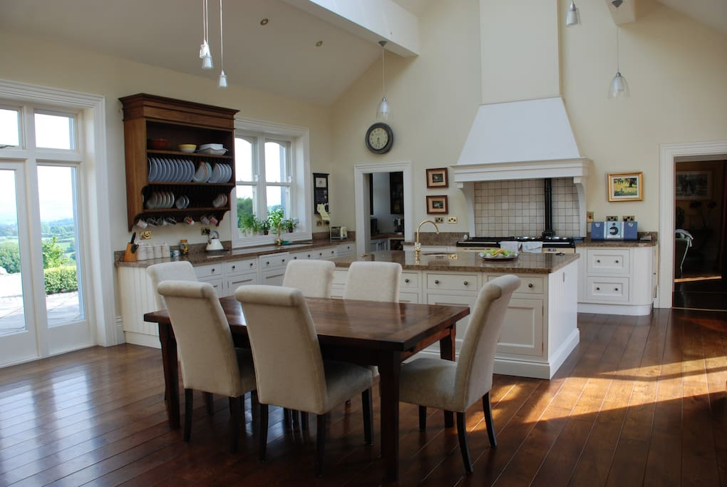 Large bright kitchen with Aga and extending dining table