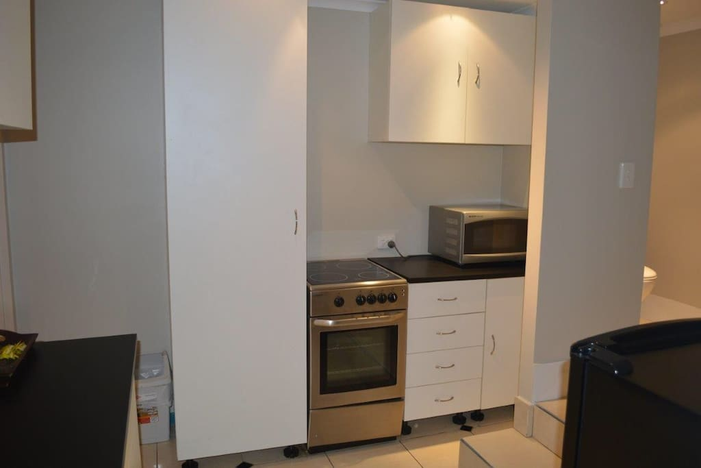 Kitchenette - oven - cooktop - microwave - fridge