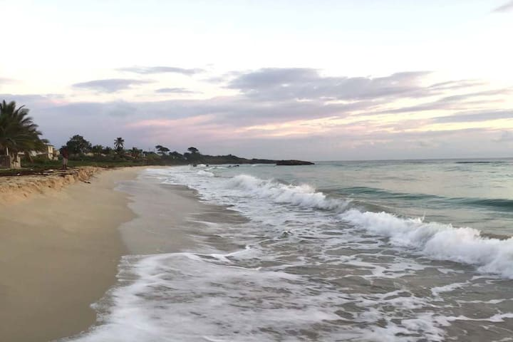 Long Bay beach stretches for one full mile.  Our villa rests directly on the sand and offers easy access to swimming, romantic walks and morning runs!