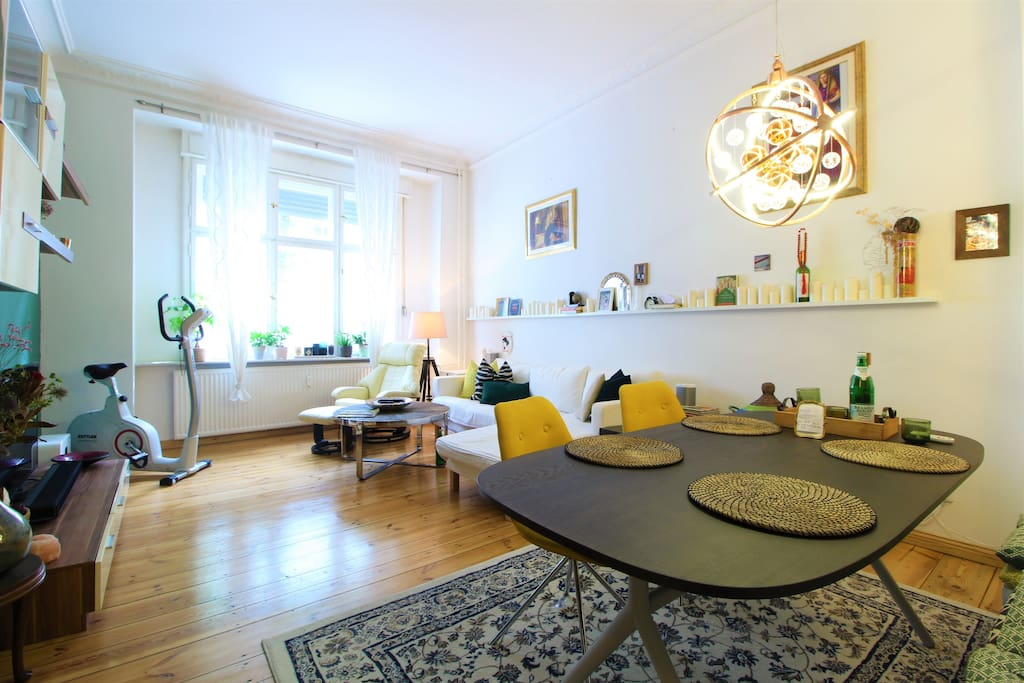 Bright & friendly living room with modern furniture and a home trainer.