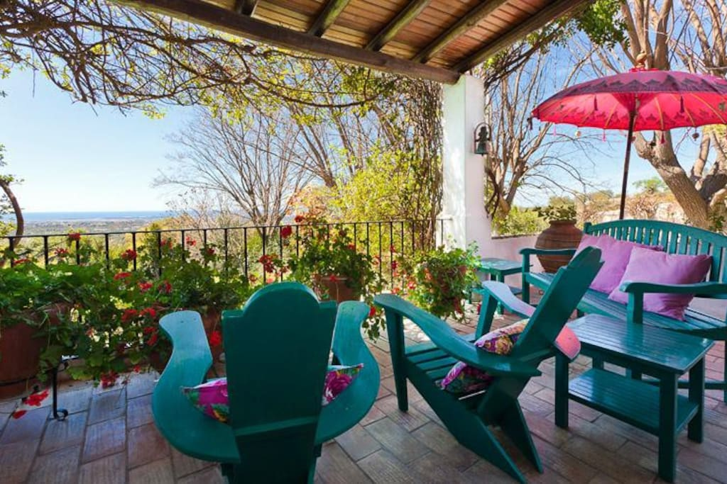The aviator chairs on the terrace with a breathtaking view over the coast of Algarve