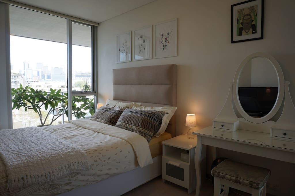 Guest room in day time.  Bed / mattress is  of highest quality.  Medium - Firm support.  All guests happy to date.  :)