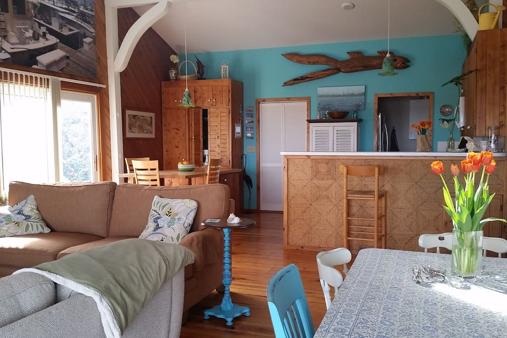 Open nautical living space with cheery sunlight
