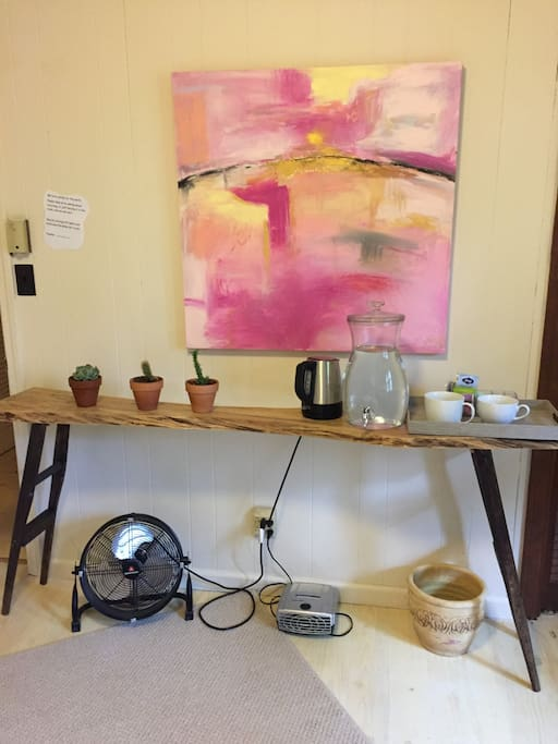 Personal coffee/Tea station along with fan and local artwork by the owner