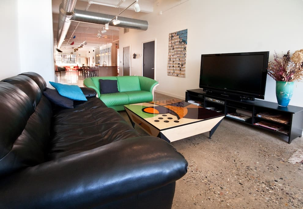 TV area with view of 120 foot long loft