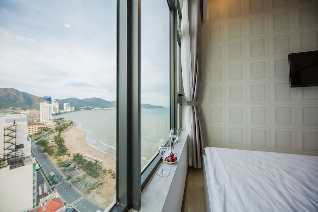Apartment is right in fron of the beach and the Hon Chong Rock