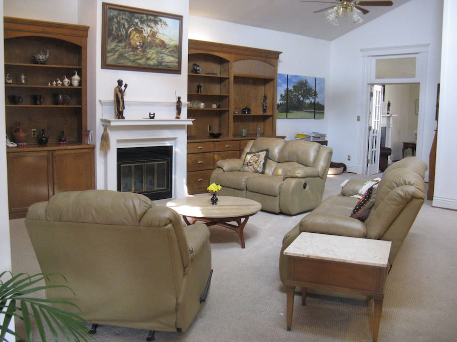 large family room with reclining chairs and fireplace