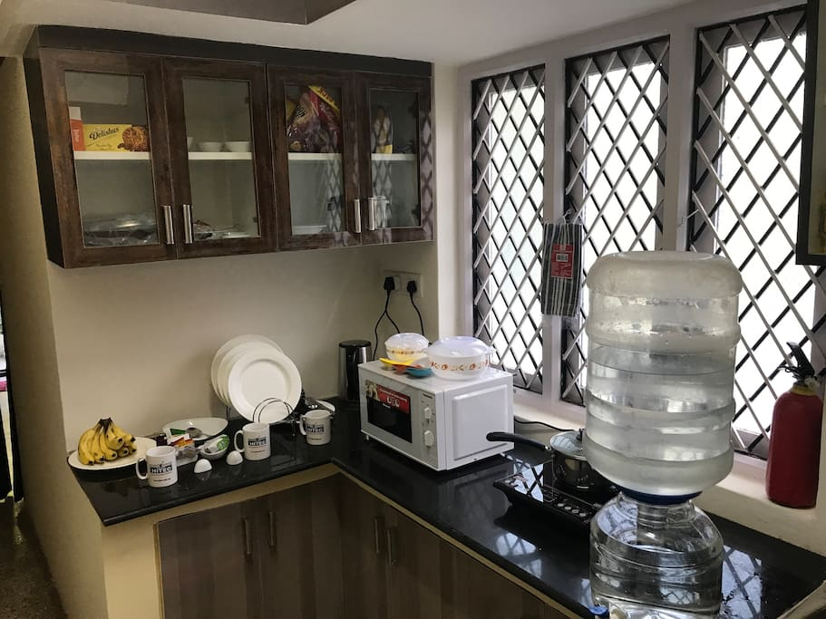 A cute fully furnished kitchen