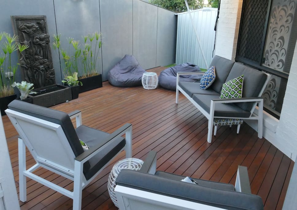 outdoor entertaining deck and tranquil  water feature