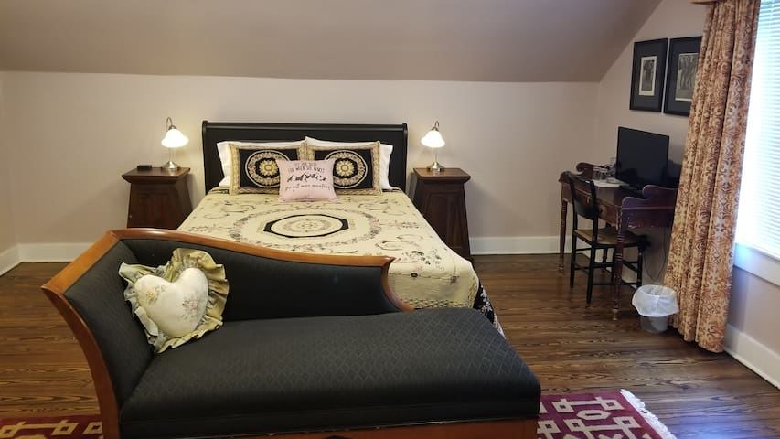 East bedroom has a comfy queen bed, writing desk, TV with Roku, large guest closet and USB charger.