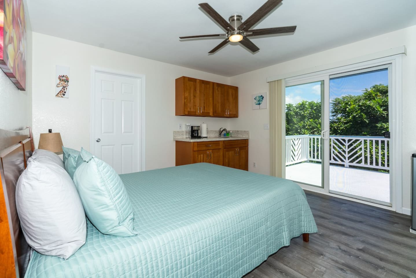 Room 6 with queen bed, AC and wet-bar with private bathroom and lanai.