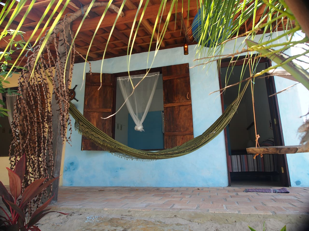 The Blue room with hamac and swing. Private patio and bathroom.