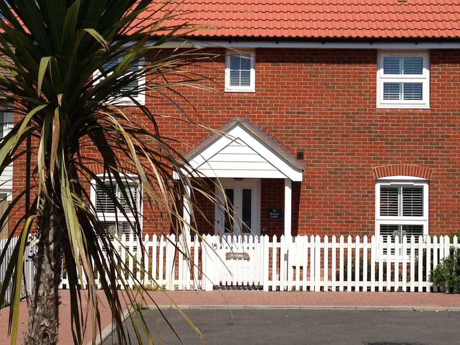 Front view of Cottage with picket fence.