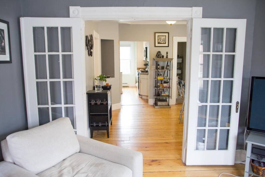 Bedroom is through the doors on the left.