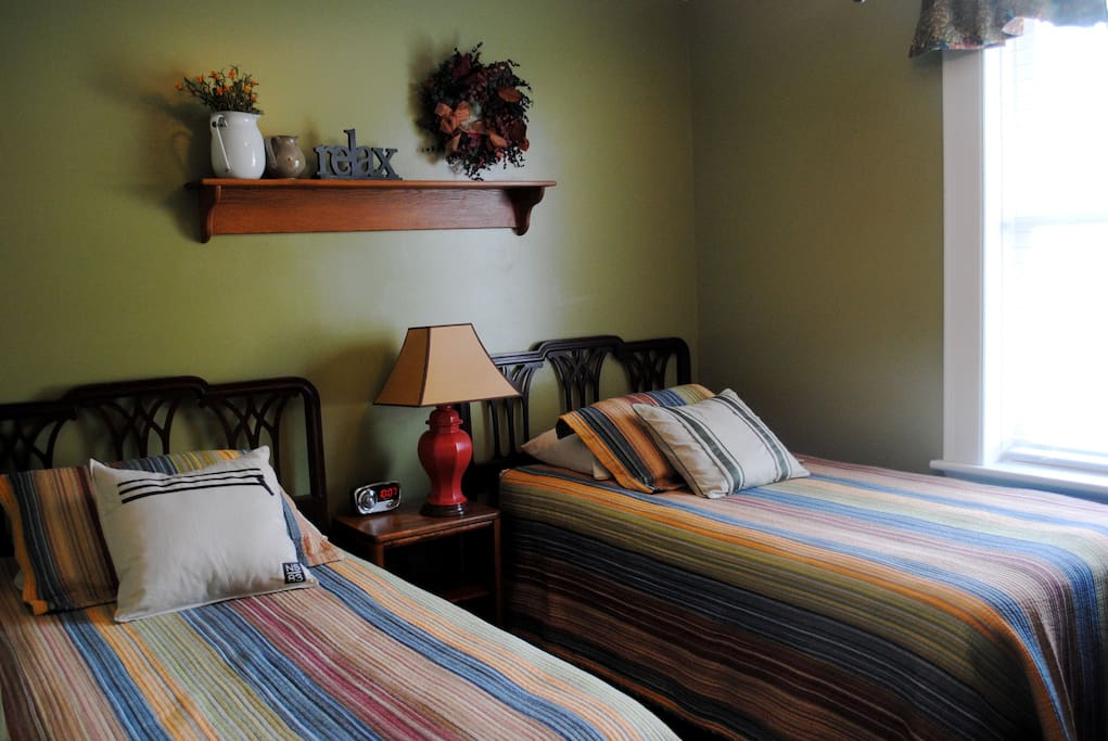 Second bedroom has two twin beds, antique dresser and desk, TV and DVD player.