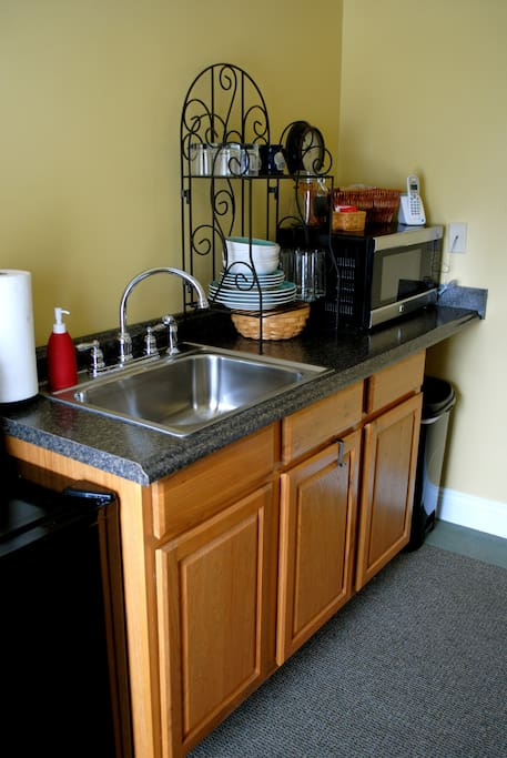 The suite's private kitchenette has fridge, microwave, coffee maker, toaster and small table.  Kitchen is stocked daily with breakfast items.