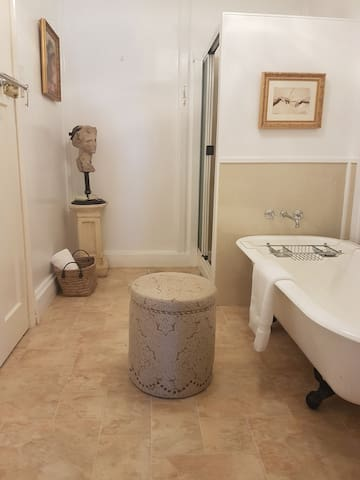 share bathroom complete with classic claw foot bath, shower and vanity.