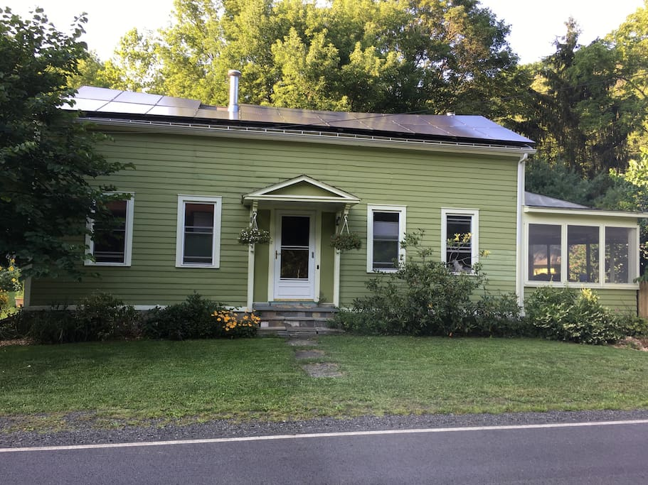 Powered by solar!  Enjoy your morning coffee on a screened porch that overlooks a perennial garden.