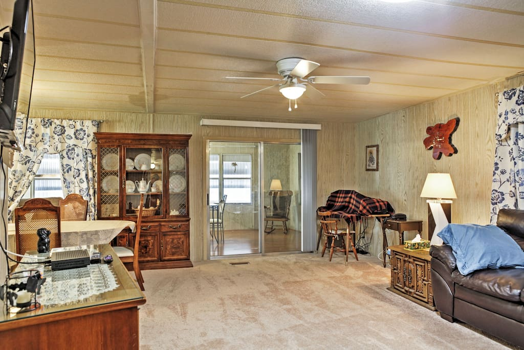Inside, the lovely home boasts 2 bedrooms, 2 bathrooms and charming decor.