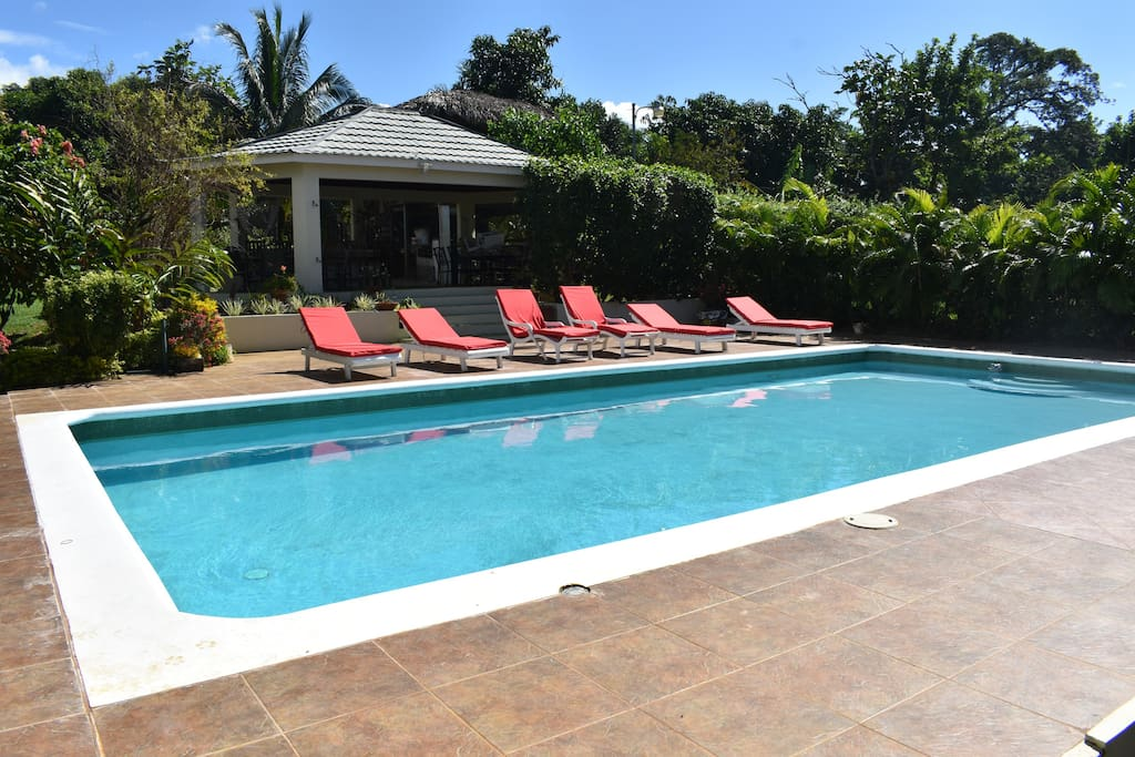 Large pool, chairs to relax on and a cabana to enjoy cool drinks and barbecue under.
