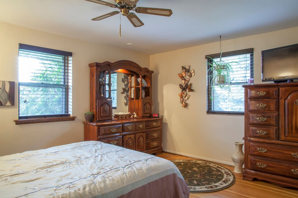 Beautifully furnished room with hardwood floors.