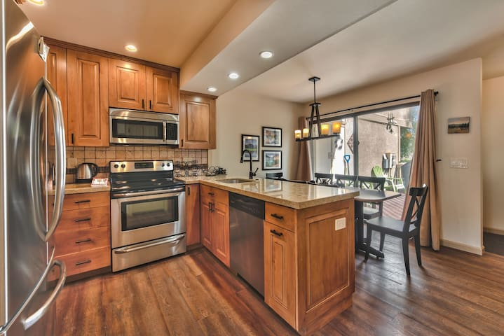 Fully Equipped Kitchen with Custom Cabinets, Granite Counters, Stainless Steel Appliances